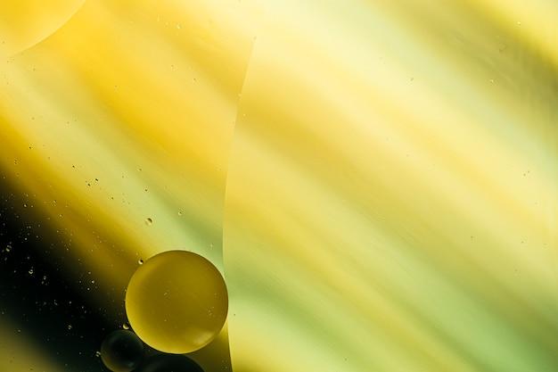 Teste padrão abstrato de bolhas coloridas do óleo na água