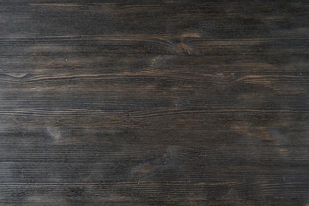 Teste padrão de madeira do fundo da textura marrom preta escura.