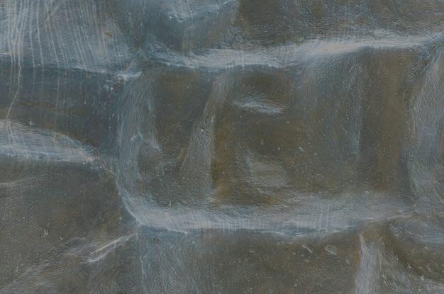 Teste padrão de mármore abstrato da superfície do close up na pedra de mármore preta para decorar no fundo da textura do jardim
