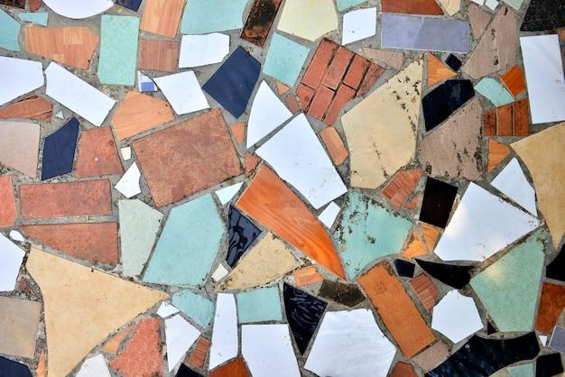 Teste padrão de mosaico quebrado das telhas para o fundo da textura.