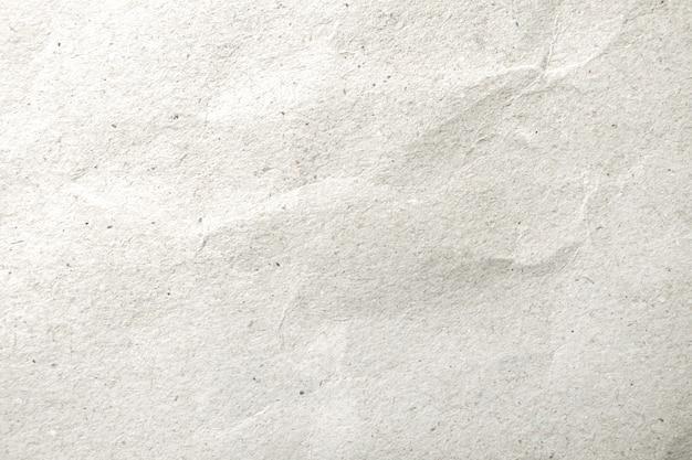 Teste padrão de papel amarrotado branco e fundo da textura.