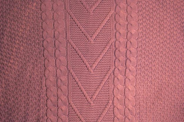 Teste padrão do close up feito malha colorido das camisolas. produto artesanal de lã merino. padrões de tricô.