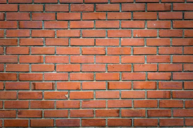 Teste padrão do tijolo do close up na parede de tijolo marrom fundo.