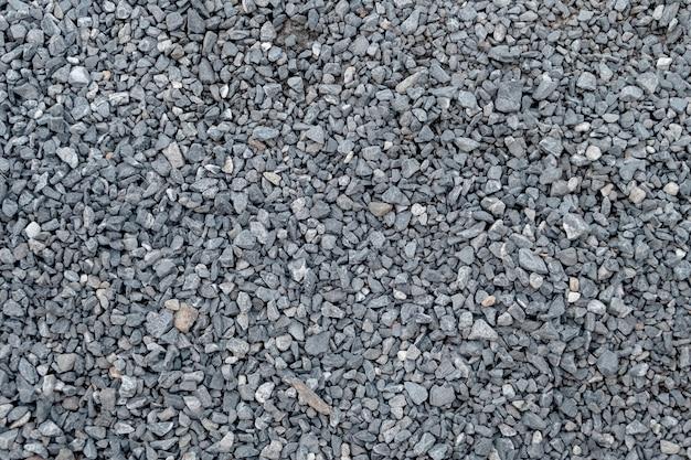 Teste padrão e textura do cascalho do granito para a paisagem e a construção.
