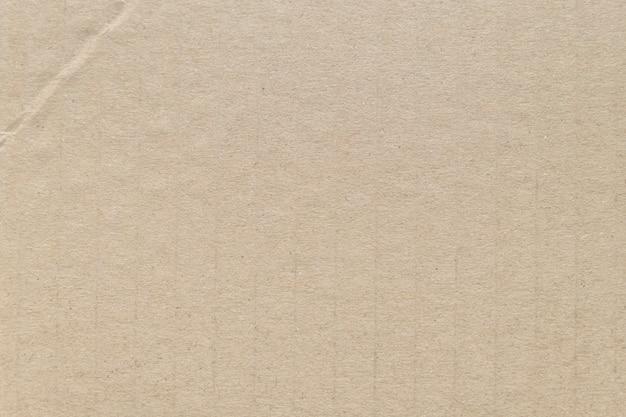 Teste padrão e textura do papel do cartão de brown para o fundo.
