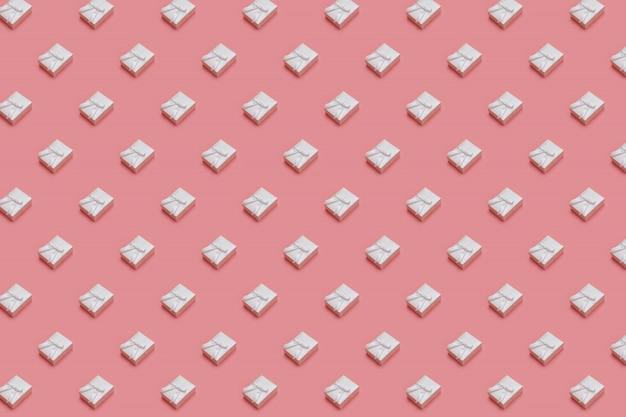 Teste padrão feito das caixas de presente brancas no fundo do rosa pastel. presentes em isométrico