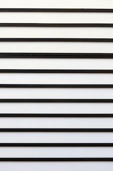 Teste padrão moderno abstrato com as listras paralelas preto e branco.