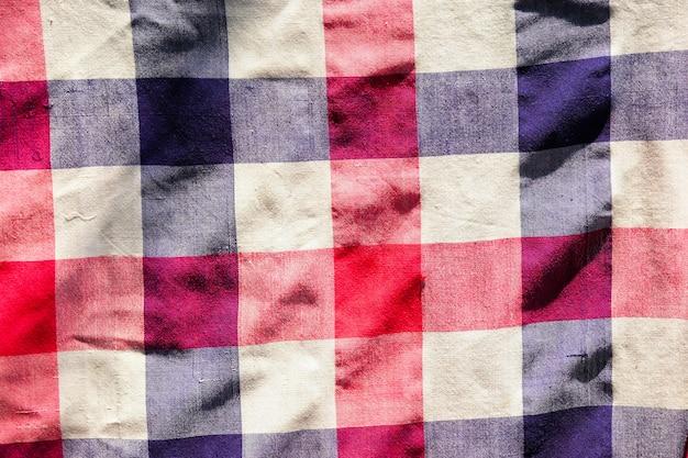Teste padrão vermelho, azul e branco da tanga para o fundo ou a textura.