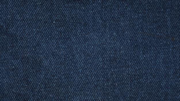 Têxteis de jeans azul índigo para textura e plano de fundo.