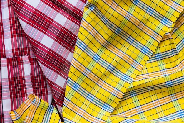 Têxtil de padrão de tartan vermelho e amarelo