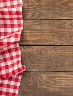 Têxtil de toalha de mesa em mesa de madeira com lugar para texto