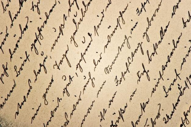 Texto caligráfico escrito à mão indefinido. fundo de papel digital