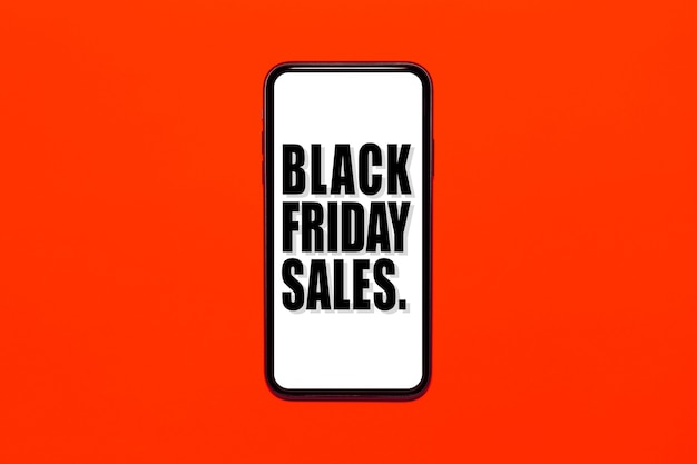 Texto das vendas de sexta-feira negra na tela do smartphone. fundo de cor vermelha ou exuberante de lava.
