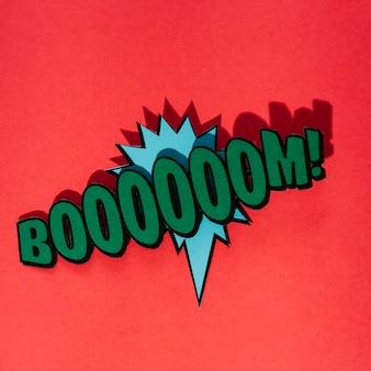 Texto de boom verde sobre o balão azul contra o fundo vermelho