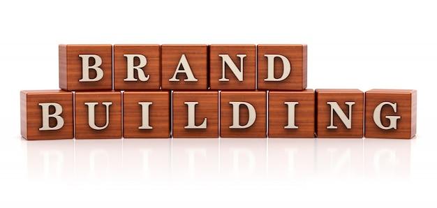 Texto de construção de marca em cubos de madeira