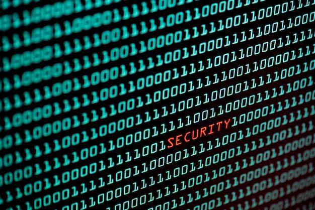 Texto de segurança e conceito de código binário da tela do desktop, foco seletivo
