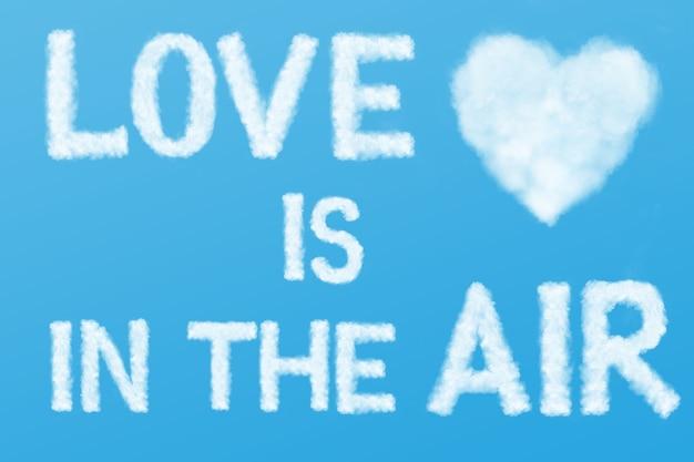 Texto o amor está no ar e a nuvem do coração no céu azul