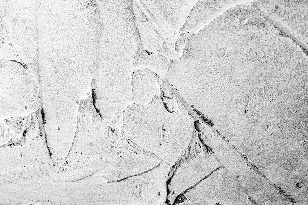 Textura abstrata cinza com manchas e respingos de gesso