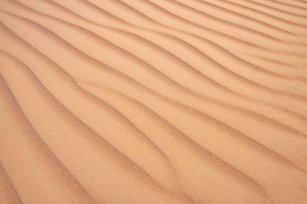 Textura abstrata das ondas de areia no deserto