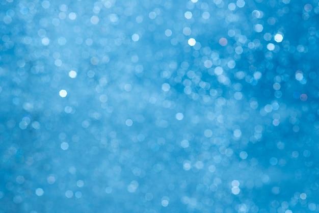 Textura abstrata de bokeh azul. luz brilhante turva à noite.