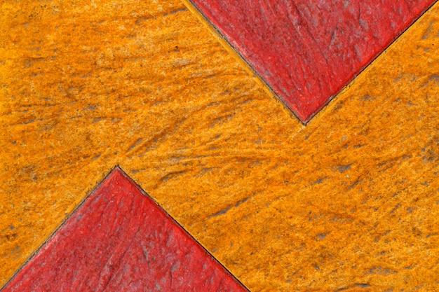 Textura abstrata de concreto colorido, amarelo e vermelho