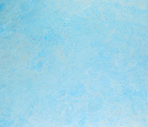 Textura abstrata de fundo de gesso áspero com salpicos brancos de azul.
