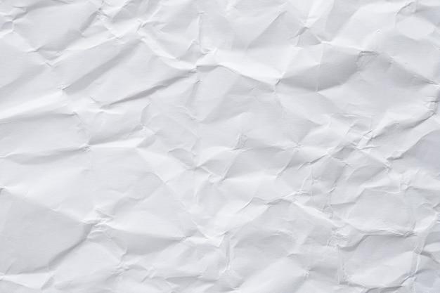 Textura abstrata de papel branco amassado