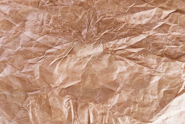 Textura abstrata fundo velho enrugado reciclagem papel marrom, foto tonificada