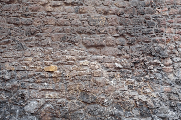 Textura. alvenaria de parede. edifício histórico de perto.