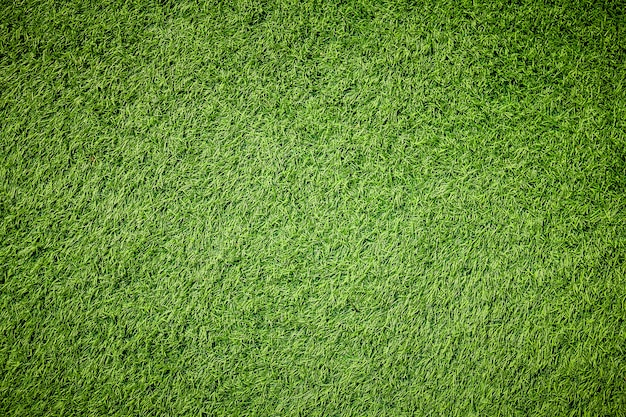 Textura artificial de grama verde com filtro vintage pode ser usada como plano de fundo