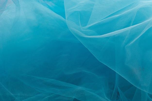 Textura azul clara usada como plano de fundo. textura de tecido leve azul. textura de pele sintética azul close-up