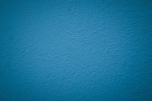 Textura azul da parede do cimento do grunge abstrato.