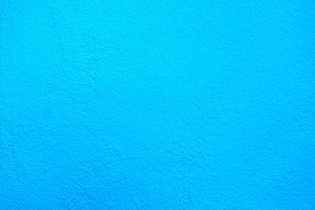 Textura azul do cimento ou do muro de cimento para o fundo.
