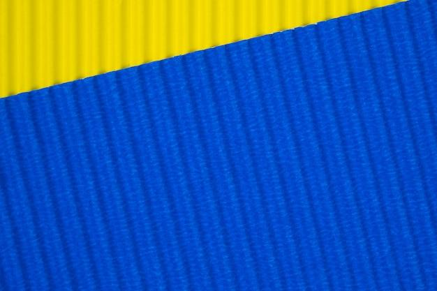 Textura azul e amarela do papel ondulado, uso para o fundo. cor vívida com espaço vazio para adicionar texto ou objeto.
