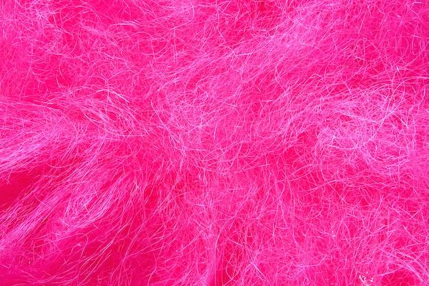 Textura bagunçada de cabelo rosa artificial