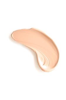 Textura bege beleza cosmética isolada no fundo branco manchada maquiagem emulsão creme ou fo ...