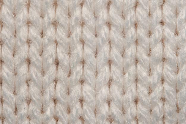 Textura bege de macro de camisola de malha
