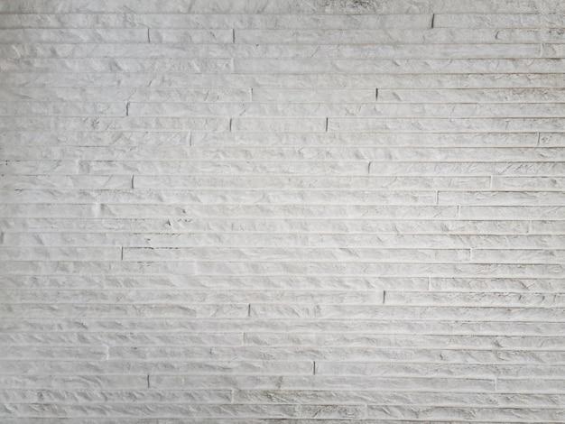 Textura branca abstrata da parede do cimento do grunge.