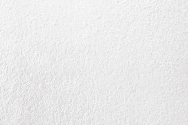 Textura branca da parede do cimento do grunge para o trabalho de arte do fundo e do projeto.