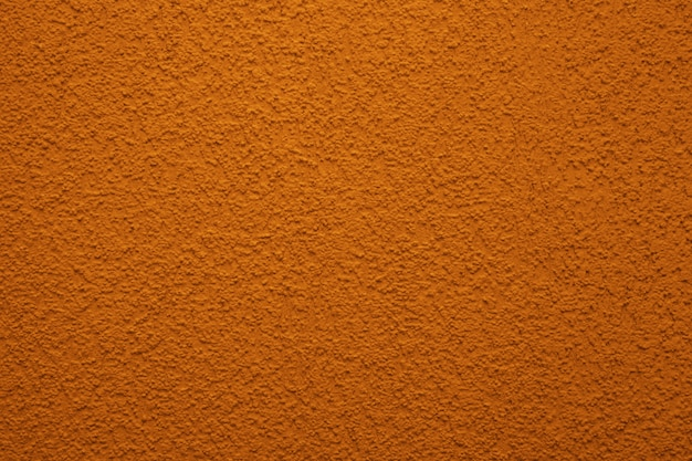 Textura brilhante, colorida do muro de cimento, fundo pintado - cor alaranjada. papel de parede de gesso.