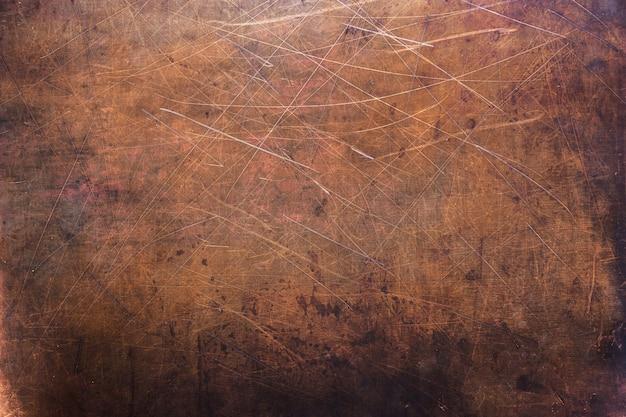 Textura brilhante de cobre ou latão como pano de fundo para o design