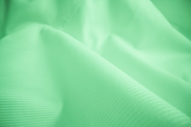 Textura brilhante de pano fluindo no tiro macro.