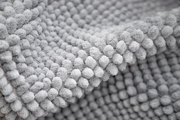 Textura cinza claro do tapete capacho