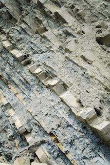 Textura cinza em camadas rochosas, plano de fundo