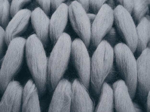 Textura cinzenta da malha do fio do merino.