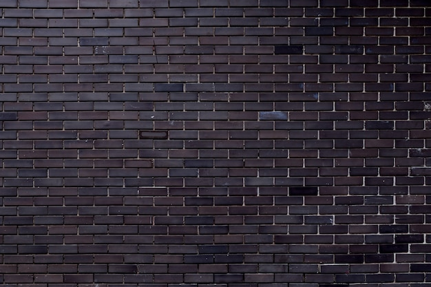 Textura cinzenta da parede de tijolo com sujo da construção usando-se para o fundo.