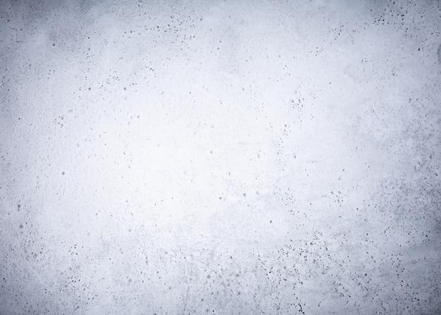 Textura cinzenta do fundo da pedra concreta.