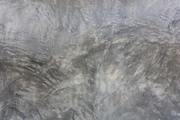 Textura cinzenta velha do muro de cimento.