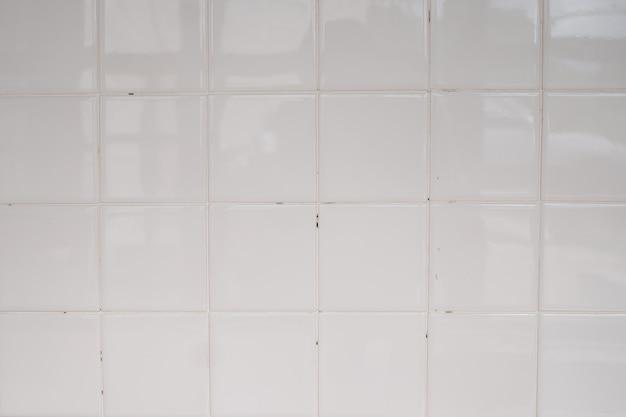 Textura clássica da parede de azulejos para o interior