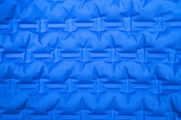 Textura com tecido ondulado azul. foto de alta qualidade